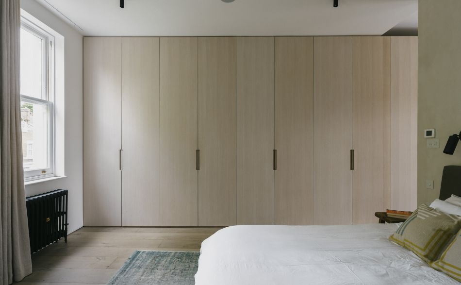Bespoke fitted wardrobes with tall oak doors