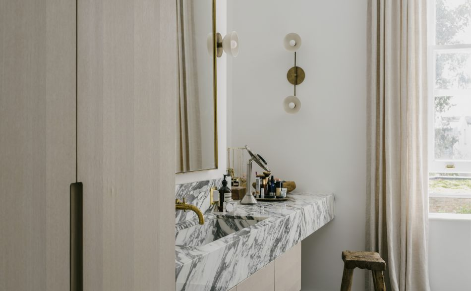 Marble vanity unit with oak wardrobe doors on right