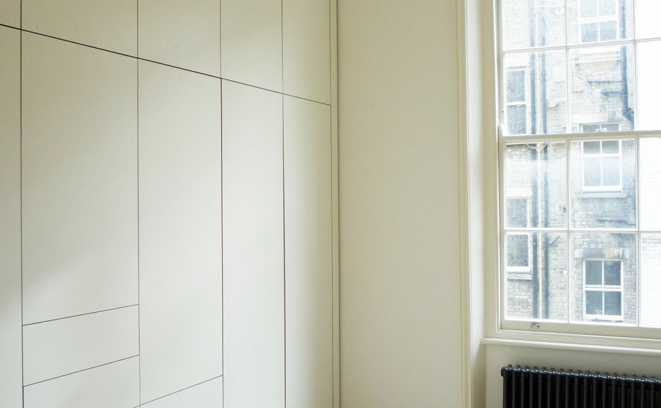 Graphic face-on view of fitted storage in white