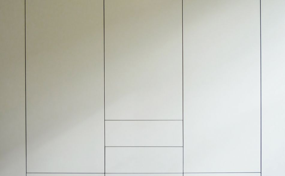 graphic grid created by the handleless fitted storage