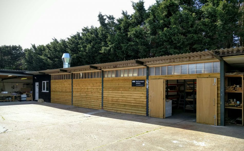 Exterior of finishing workshop with timber cladding
