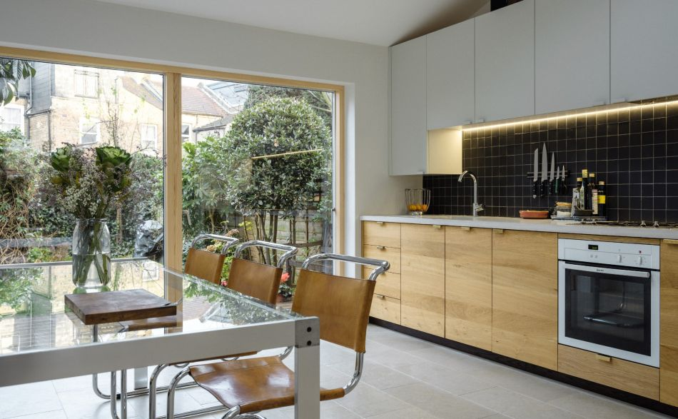 modern galley kitchen with solid oak doors and a concrete worktop