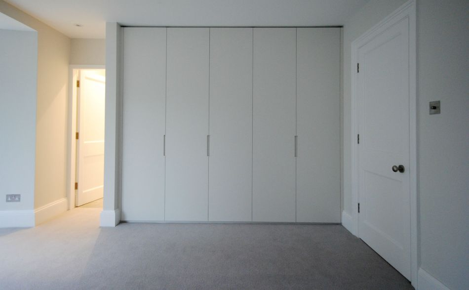 Bedroom with modern handleless wardrobes in Farrow & Ball Strong White